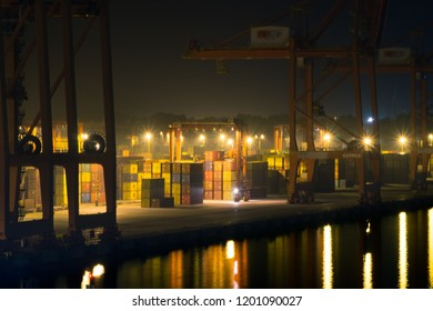 Gdynia, Pomorskie / Poland - October 10 2018: Containers laying on at Baltic Container Terminal in Gdynia during the night