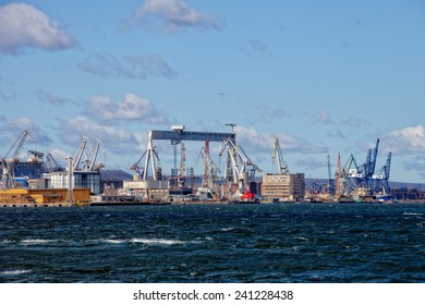 GDYNIA,POLAND-APRIL 02:View of the shipyard and 1000-ton Gantry Crane in Shipyard, on April 02, 2012 in Gdynia, Poland.One of the largest in Europe Gantry Cranes with dimensions of 106m high,153m wide