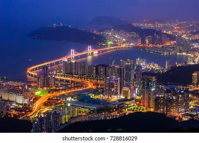 GeangAn Bridge and Haeundae beach at night in Busan city, South Korea.