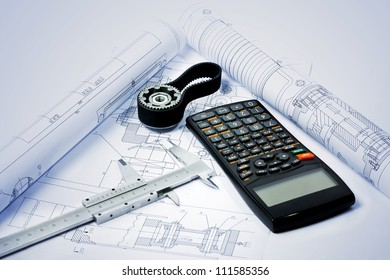gear with caliper and calculator on blueprint