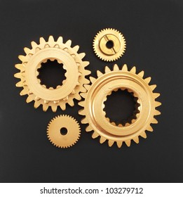 gear gold on a black background