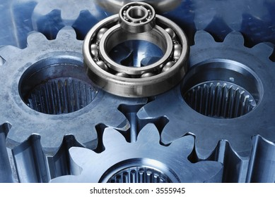gear mechanism in blue metallic with one bearing in silver