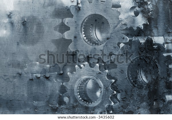 gear mechanism in old flaky paint background, abstract idea
