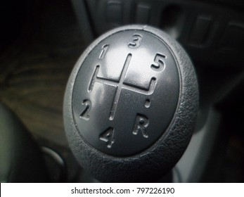 Gear stick displaying five speed and reverse