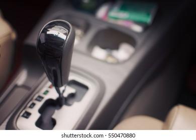Gear stick on auto transmission car. selective focus.