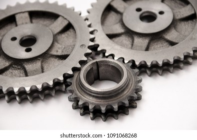 A gear wheel or pinion is a basic part of a gear train in the form of a disc with teeth on a cylindrical or conical surface meshing with the teeth of another gear