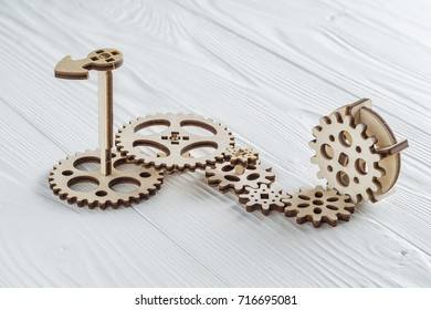 Gear wheels on white wooden background. The concept of creative, logical thinking.