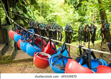 Gear for zip lining hangs on ropes in the forest of Costa Rica.