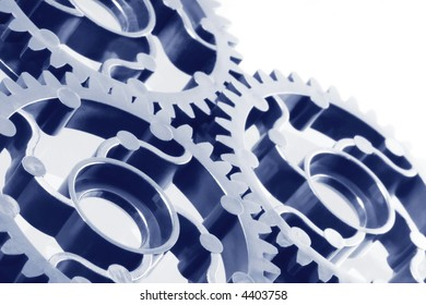 Gears interconnected, in blue duotone.