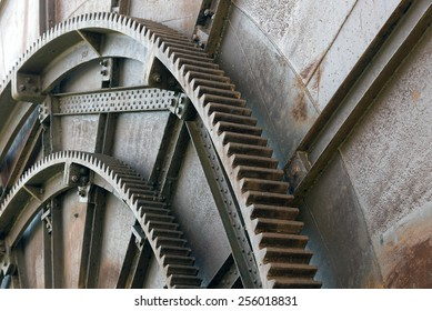 Gears of machinery in an old abandoned factory