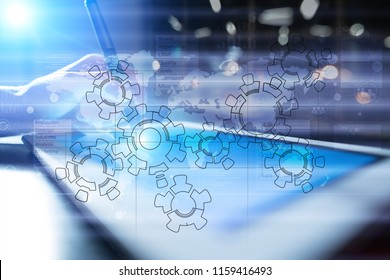 Gears, mechanism design on virtual screen. CAD systems. Business, industrial and technology concept.