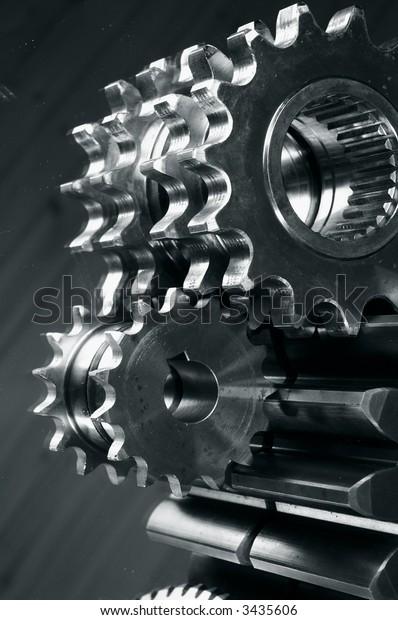 gears and mirror reflection idea in dark metallic toning