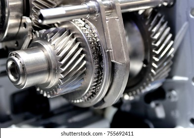 Gears on an axle in an opened gearbox.