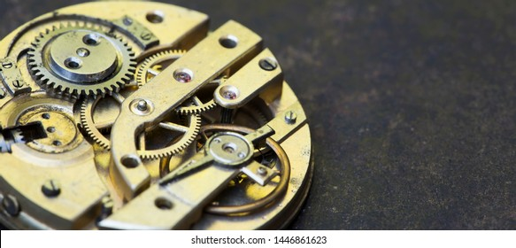Gears of a vintage metal business clock watch close-up, time mechanism web banner