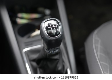 A gearstick or gear shifter in a manual car left in neutral whilst parked
