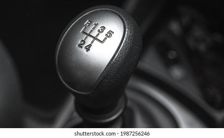 Gearstick transmission inside black interior car, close-up