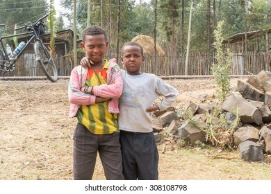 Gebre Guracha, Ethiopia - February 16, 2015: Close up picture of the young  boys staying by the road. Picture was taken when riding on the road number 3 near Gebre Guracha in Ethiopia.