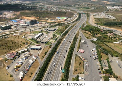 Gebze, Kocaeli, Turkey - September 4, 2018. Aerial view over Anatolian highway E80 with commercial and residential properties and traffic.