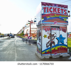 Geddes, New York, USA. August 23, 2018. Ticket booth on  the west end and part of the midway of the New York State Fair
