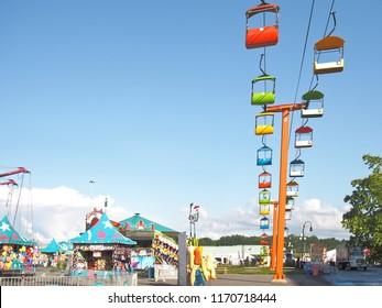 Geddes, New York, USA. August 23, 2018. Landscape of the west end and part of the midway of the New York State Fair with the Broadway Slyliner Sky Ride, also known as the chair lift ride