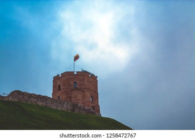 Gediminas' Tower with Lithuanian flag waving, view from remaining part of the Upper Vilna Castle, Vilnius, Lietuva (Lithuania). October 23, 2018.