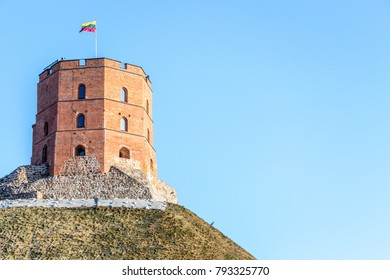 Gediminas tower in Vilnius, Lithuania with Lithuanian flag