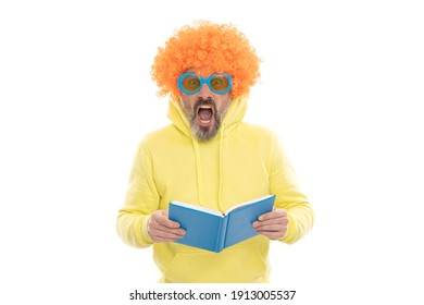 Geeky bibliophile in funky wig keep mouth open reading school book, library.