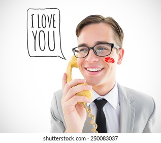 Geeky businessman talking on retro phone against white background with vignette
