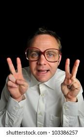 Geeky guy gives two peace symbols