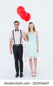 Geeky hipster couple hands in hands looking at camera on white background