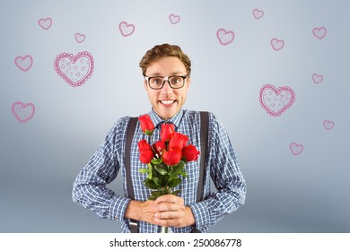 Geeky hipster holding a bunch of roses against grey vignette