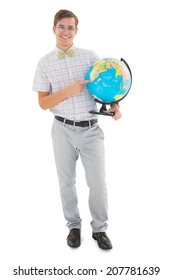 Geeky hipster holding a globe smiling at camera on white background