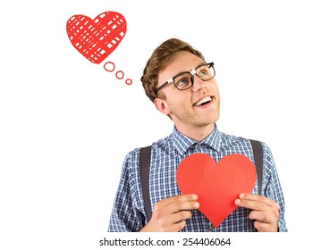 Geeky hipster holding a heart card against heart