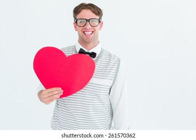 Geeky hipster holding heart card on white background