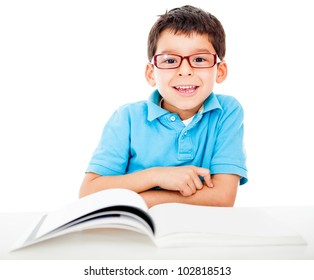 Geeky little boy studying and wearing glasses - isolated over a white background
