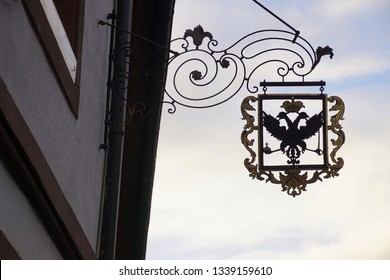 GEGENBACH, GERMANY - DEC 20, 2018 - Iron shop signs along the main street of  Gegenbach, Germany