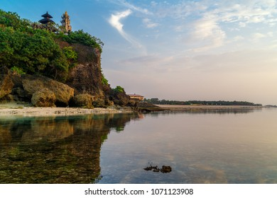 Geger beach and Pura Geger in Nusa Dua, Bali, Indonesia. Tradition Balian temple on cliffe over water