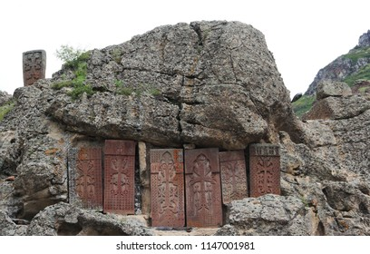 Geghard, Armenia, Cave monastery of Gegardavank in the gorge of the mountain river Gokht. Old khachkar, also known as an Armenian cross-stone, in stony wall.