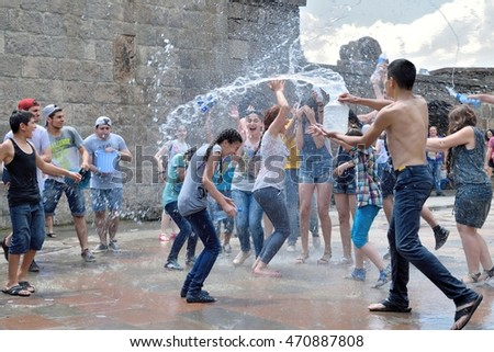 GEGHARD, ARMENIA - JULY 03, 2016: Vardavar celebration where people of social groups drench each other with water. Although now a Christian tradition, Vardavar's history dates back to pagan times
