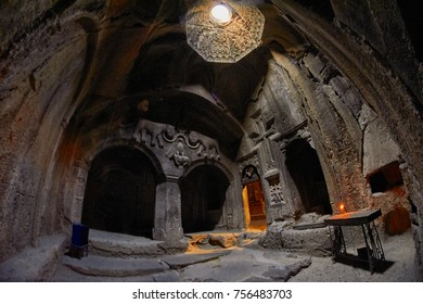 GEGHARD MONASTERY, ARMENIA - AUGUST 04, 2017: Geghard Monastery Mystic Interiors with mixture of natural and artificial lights