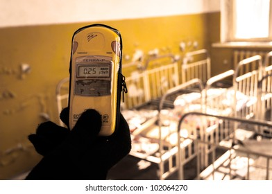 Geiger counter in nursery at Chernobyl with blurry background
