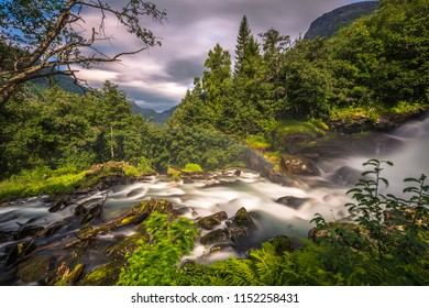 Geiranger - July 30, 2018: Waterfall in camping site in Geiranger, Norway