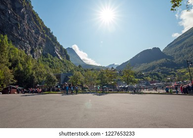 Geiranger, Norway - 10 august 2017: Geiranger Fiord with tourists. Hill in background. Beautiful landscape. Norway