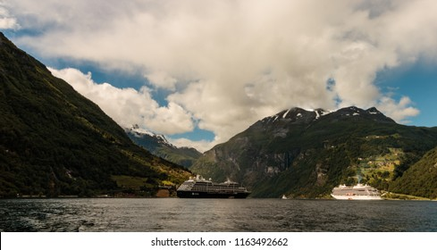 Geiranger, Norway - 2018. Picturesque summer scene of Geiranger port, western Norway.  Cruise ships docked in the port of Geiranger, Norway.