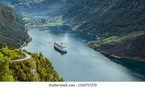 Geiranger, Norway - Aug. 6, 2018: The Geiranger Fjord and the Geiranger village at its end. The fjord was listed as a UNESCO World Heritage Site.