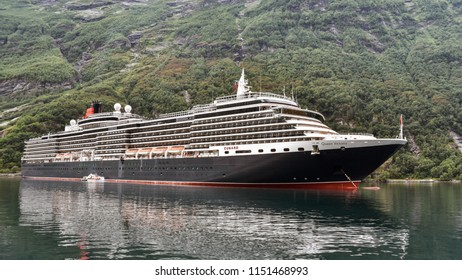 Geiranger, Norway - Aug. 7, 2018: MS Queen Victoria of the Cunard Line anchors at Geiranger Fjord, Geiranger, Norway.