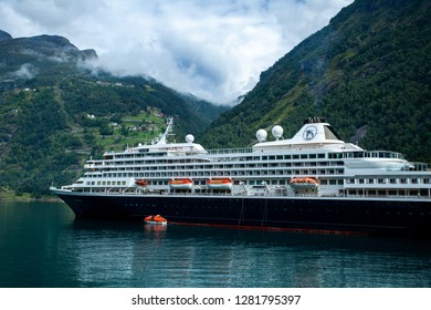 Geiranger, Norway - August 14, 2014: Cruise ship visiting Geiranger, Norway. This fjord is called Geirangerfjorden. Since 2005, the Geirangerfjord area has been listed as a UNESCO World Heritage Site.