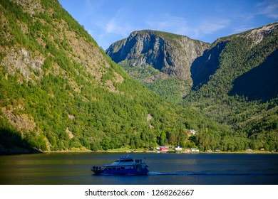 GEIRANGER , NORWAY - August 14, 2018: Ferry  with passengers in Geiranger Fjord