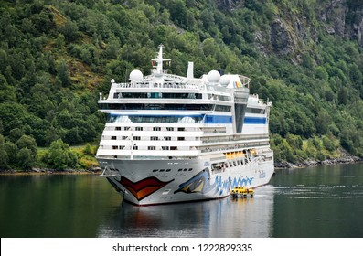 Geiranger, Norway - July 17, 2017: The cruise ship AIDAbella of the shipping company AIDA Cruises has anchored in the Geiranger fjord.