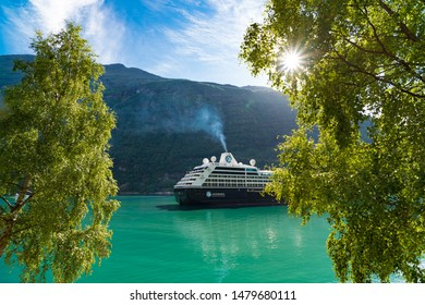 GEIRANGER, NORWAY - JULY 29, 2018: Cruise liner moored in the famous and very touristic Geiranger fjord.